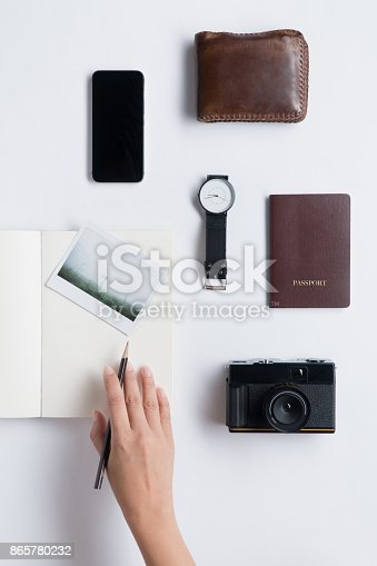 istock Flat lay of Human hand hold pencil and accessories 865780232