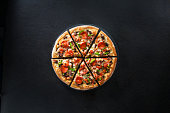 Italian pizza on dark background