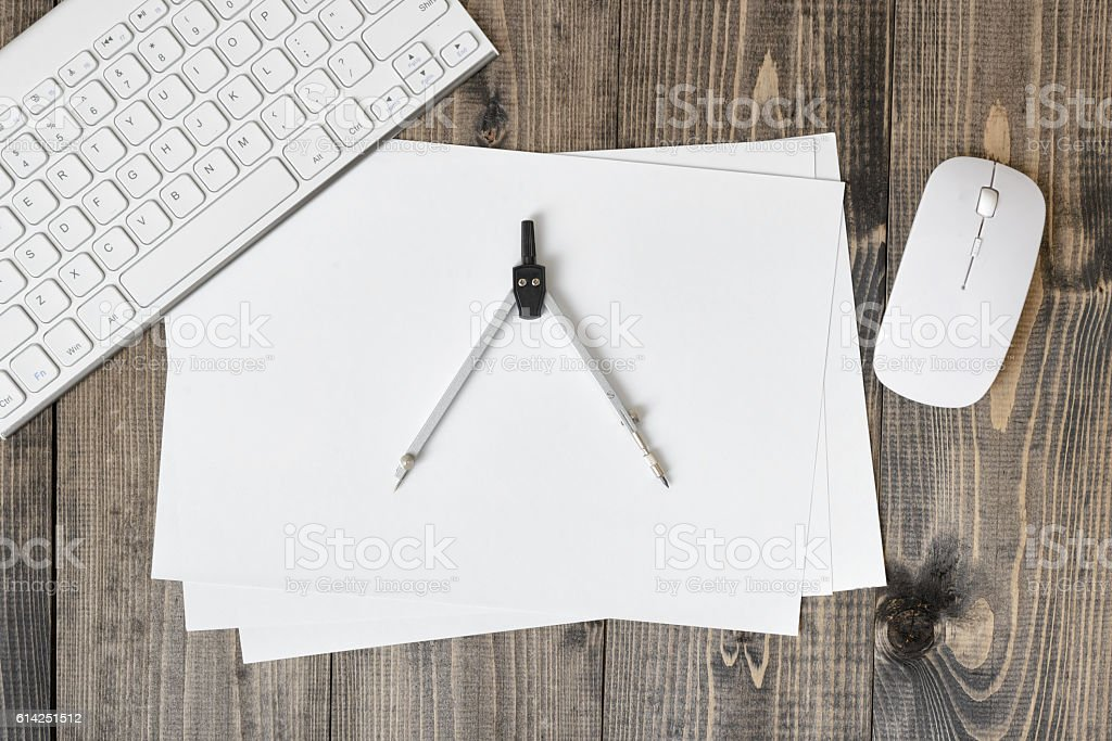 Flat lay of keyboard, pc mouse, compass and paper on stock photo