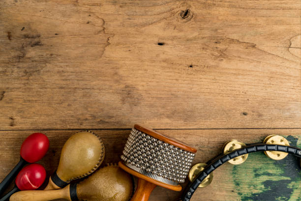 Flat lay of Latin percussion on wood desk stock photo