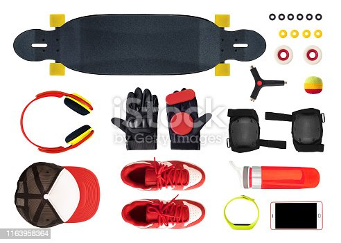 Flat lay of longboard equipment and accessories isolated on white background. Top view of skate shoes, tools, phone, etc.