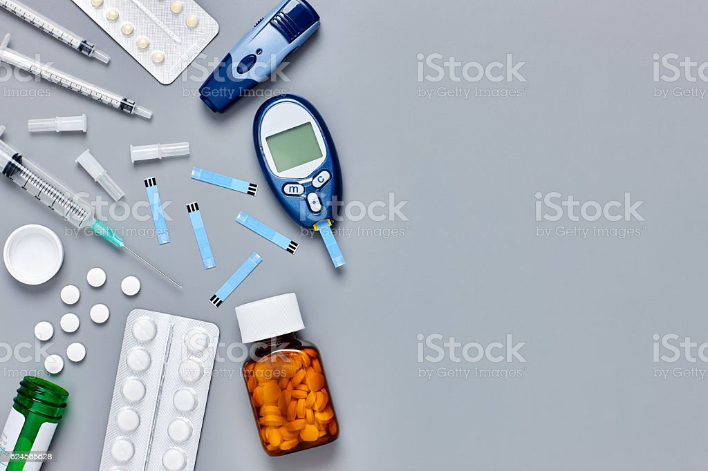 Flat lay of medical equipment on gray background stock photo