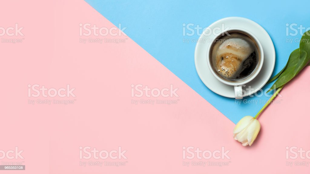 Flat lay of minimalistic picture of coffee and tulips on pink and yellow background. Minimalism coffee concept zbiór zdjęć royalty-free