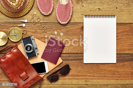 941183588 istock photo Flat lay of note pad by summer vacation accessories 624513710