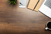 istock Flat lay of Office desk wooden table with laptop, and smartphone and equipment other office supplies 1265192451