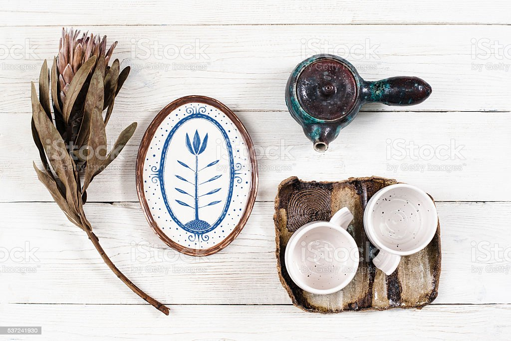 Flat lay of rustic dishes for tea stock photo