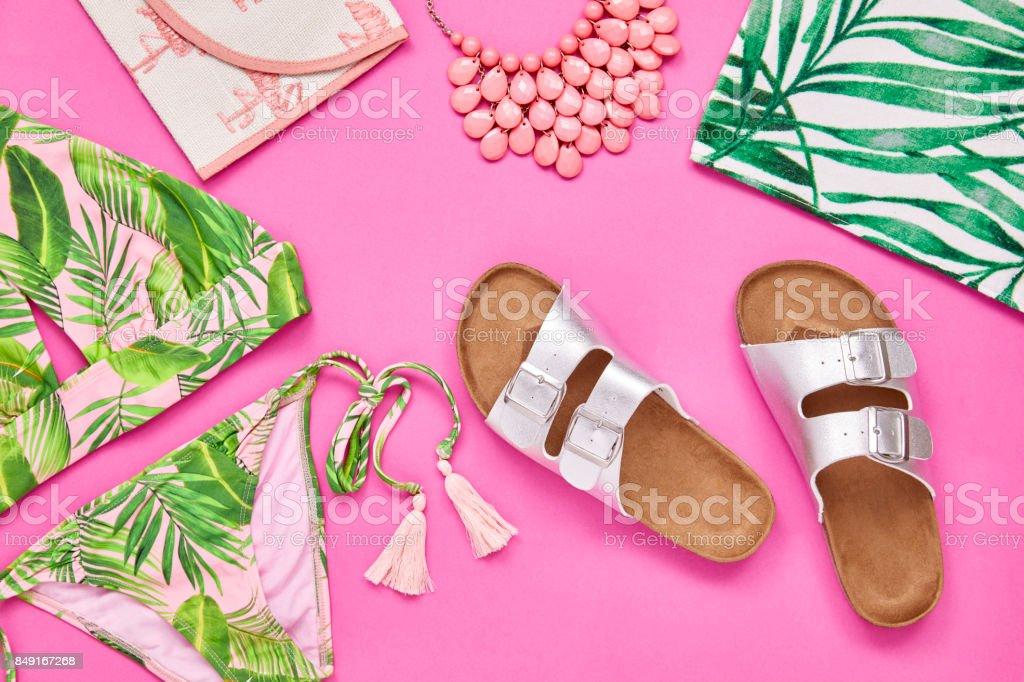 Flat lay of sandal bikini necklace beach towel and purse stock photo