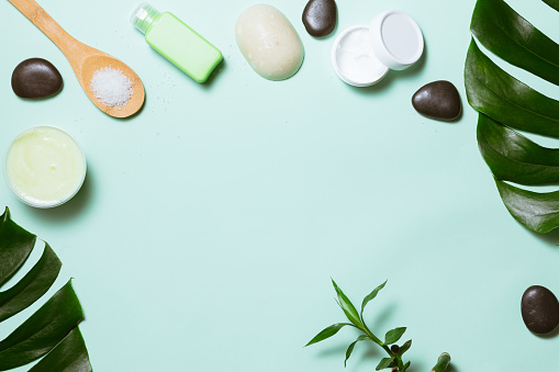 istock Flat lay of spa cosmetic with bamboo, salt for bath, cream and towel on pastel background, top view mock-up 1151624106
