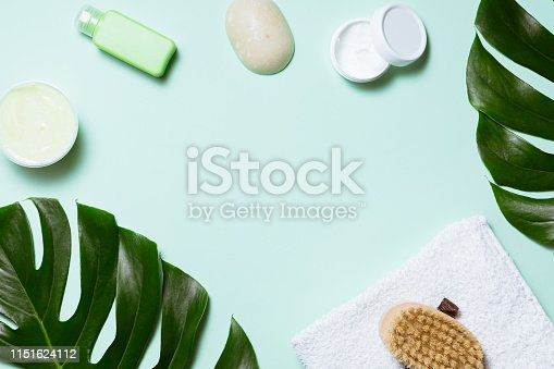 istock Flat lay of spa cosmetic with bamboo, salt for bath, cream and towel on pastel background, top view mock-up 1151624112