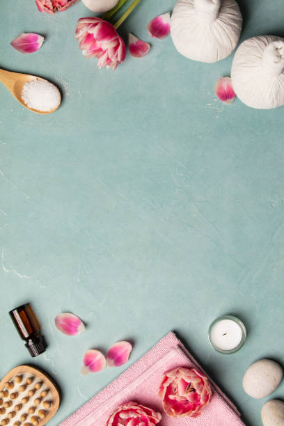 Flat lay of spa treatment set with pink flowers stock photo