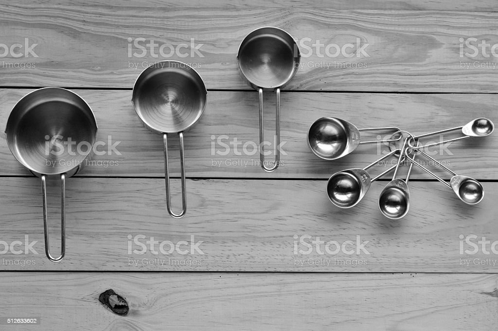 Flat lay of stainless steel measuring cups and spoons stock photo