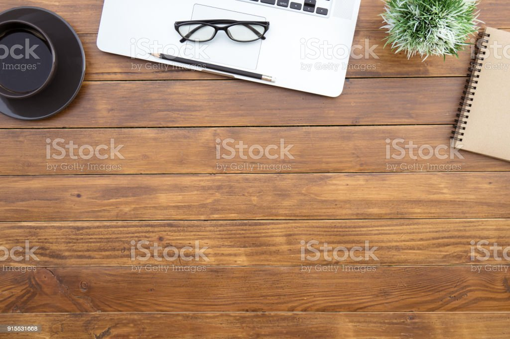 Flat lay of top view desk work table with computer laptop and...
