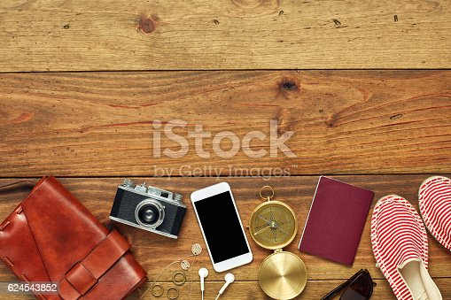 941183588 istock photo Flat lay of travel and beach accessories on wood 624543852