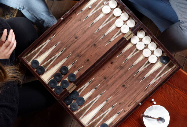 Flat lay of two people playing backgammon game. Flat lay of two people playing backgammon game while drinking tea. Top view. backgammon stock pictures, royalty-free photos & images