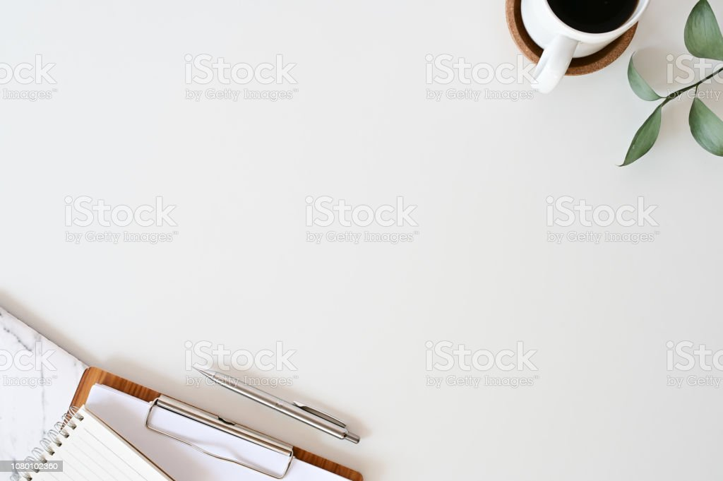 Flat lay office desk. Workspace with office supplies, pencil, green leaf with coffee and paper chart on white top view table. - Zbiór zdjęć royalty-free (Bez ludzi)