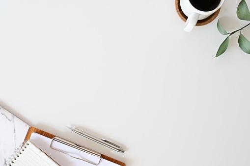 Flat Lay Office Desk Workspace With Office Supplies Pencil Green Leaf With Coffee And Paper Chart On White Top View Table - zdjęcia stockowe i więcej obrazów Bez ludzi