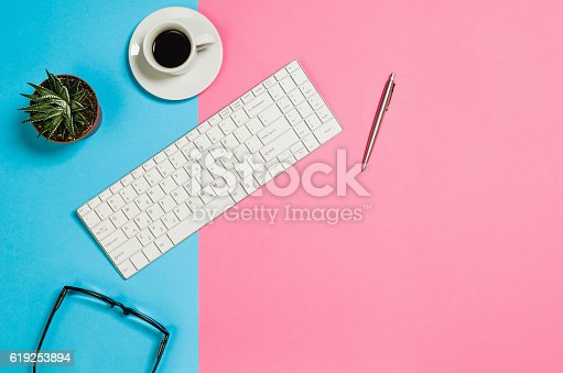 Flat lay photo of a creative freelancer woman workspace desk with copy space background. Image taken from above, top view. Minimal style with colorful paper backdrop
