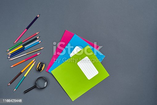 istock Flat lay photo of workspace desk with school accessories or office supplies 1166425448