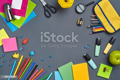 istock Flat lay photo of workspace desk with school accessories or office supplies 1166428034