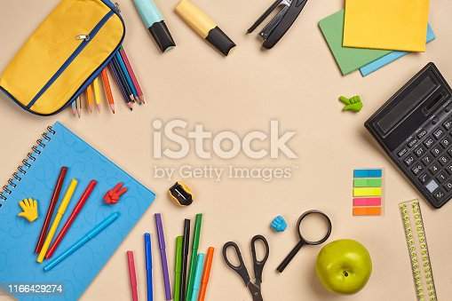 istock Flat lay photo of workspace desk with school accessories or office supplies 1166429274