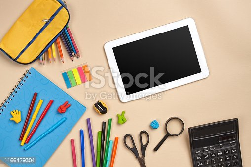 istock Flat lay photo of workspace desk with school accessories or office supplies 1166429304