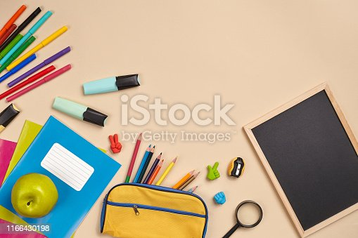 istock Flat lay photo of workspace desk with school accessories or office supplies 1166430198
