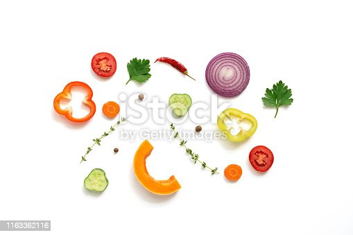 Flat lay pieces of a variety of vegetables on a white background, isolated. Top view.