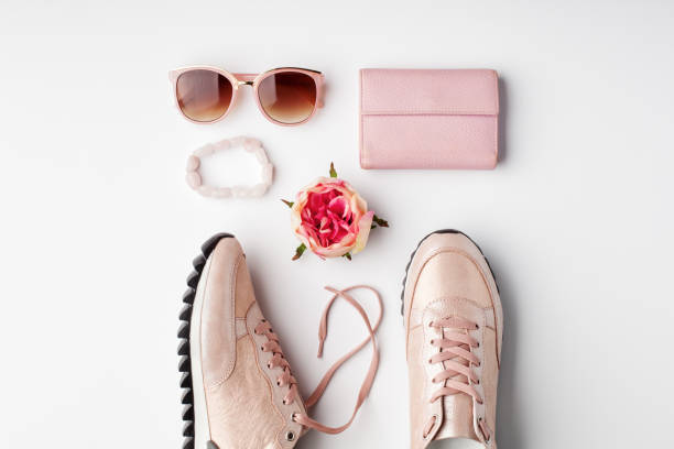 Flat lay pink feminine accessories on white background. stock photo