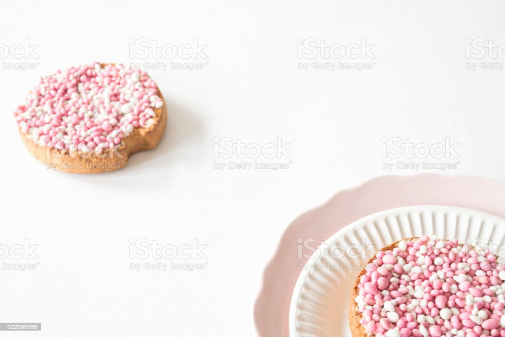 flat lay pink plate with crispy rusk with traditional Dutch food muisjes, aniseed, for celebration birth of a daughter stock photo