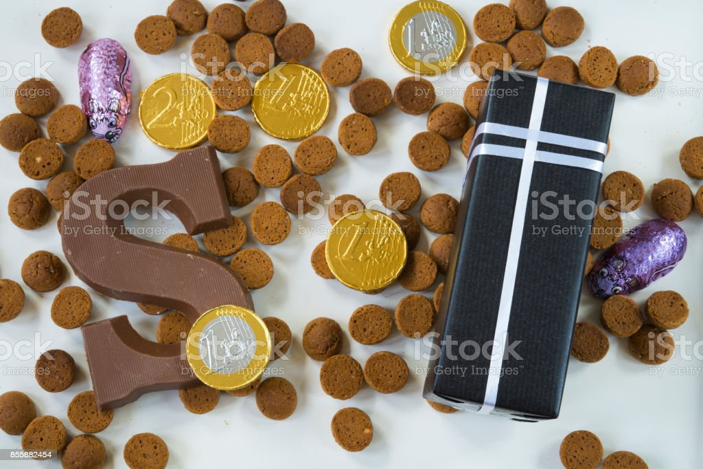flat lay, present, ginger nuts with chocolate letter, against white background, for the fifth of December, event Sinterklaas stock photo
