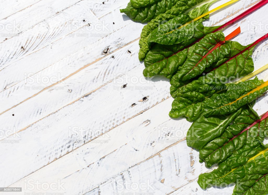 Flat lay rainbow swiss chard healthy diet background stock photo