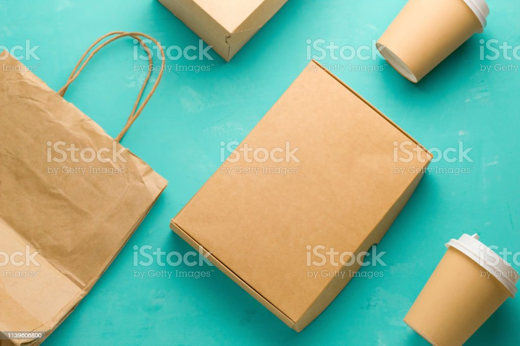 top view flat lay recyclable types of paper packaging on a blue...