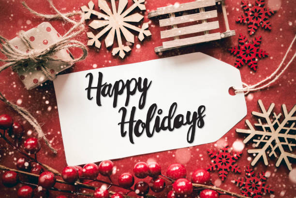 flat lay, red decoration, calligraphy happy holidays - happy holidays stock pictures, royalty-free photos & images