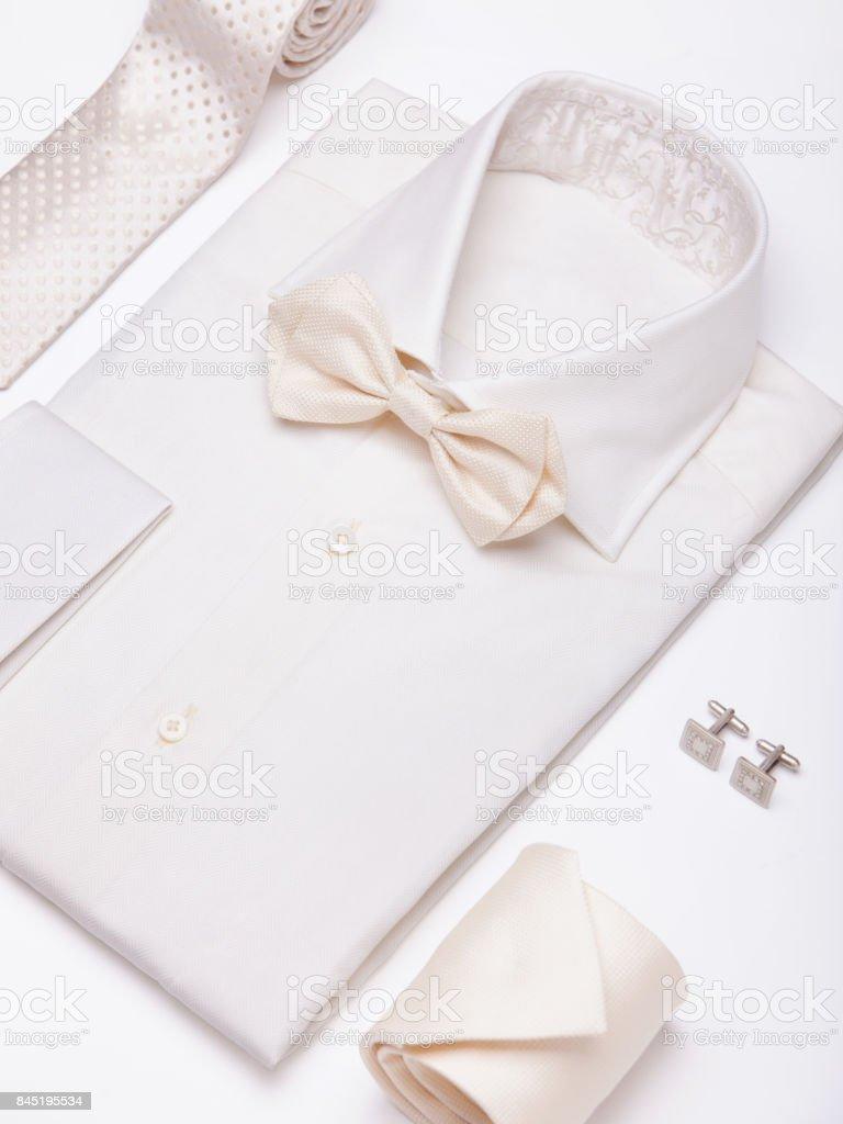 Flat lay set of clothing for men on white background stock photo