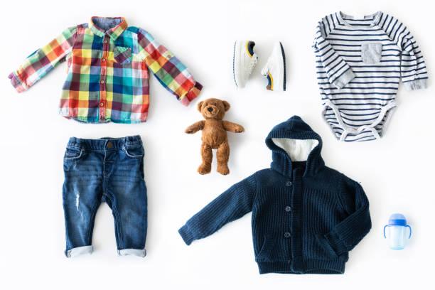 Flat lay shot of baby boy clothing. stock photo