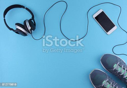 istock Flat lay shot of sneakers, earphones, phone. 812779818