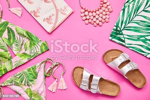 istock Flat lay shot of summer vacation accessories on pink background 849166796