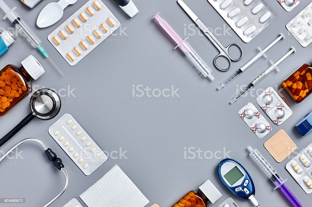 Flat lay shot of various medical equipment on gray background stock photo