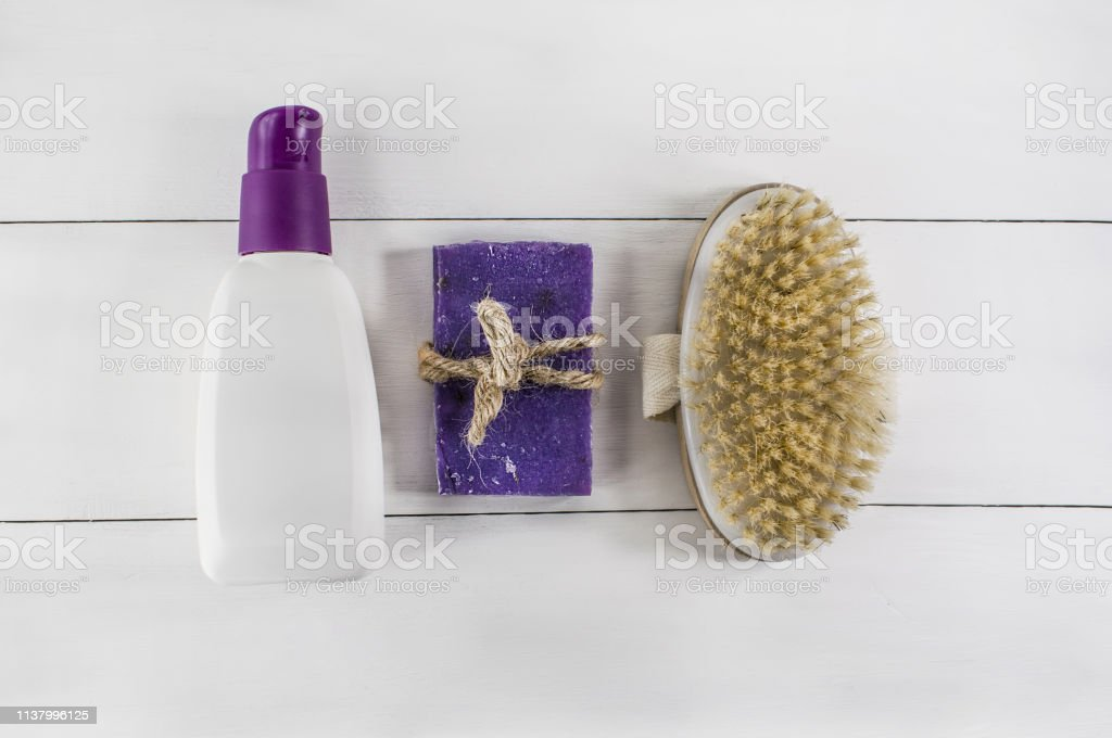 Flat lay spa bath on white wooden background, top view products for...