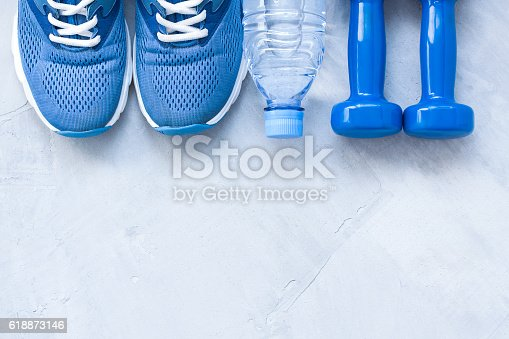 istock Flat lay sport shoes, bottle of water and dumbbells 618873146