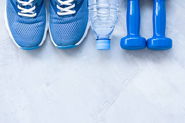 flat lay sport shoes, bottle of water and dumbbells - スポーツ医学 ストックフォトと画像