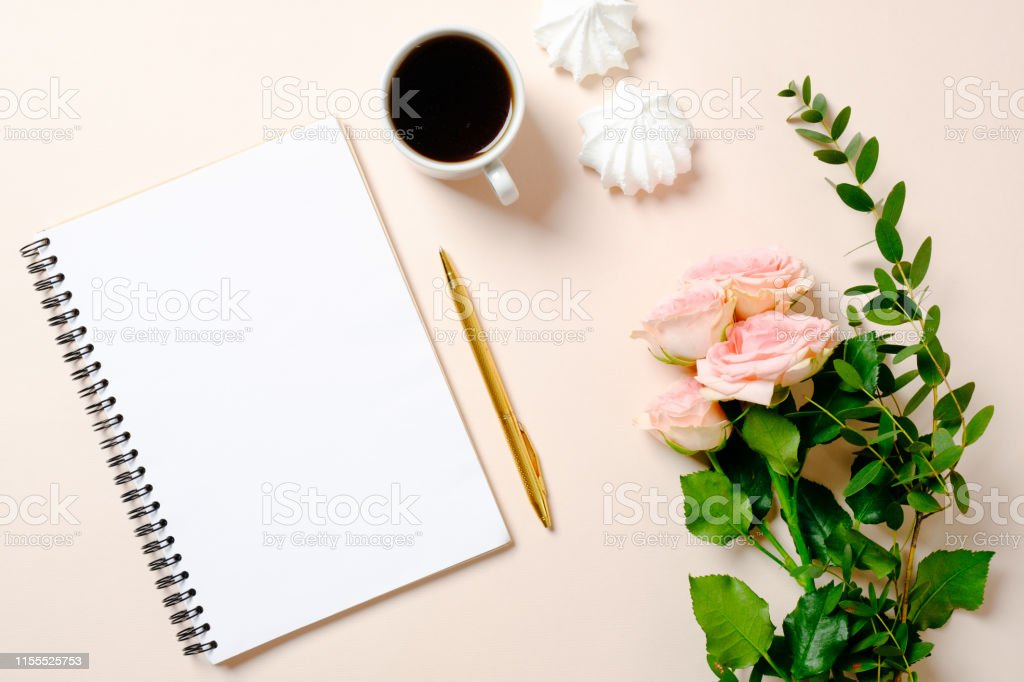 Flat lay, top view girls diary, coffee cup and flowers on pink...