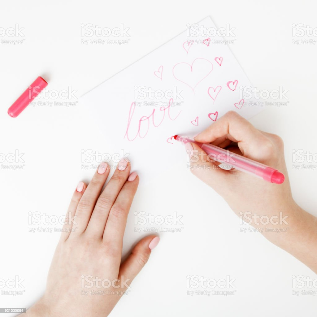 Flat lay top view hand of girl writing love letter on saint hand of girl writing love letter on saint valentines day expocarfo Choice Image