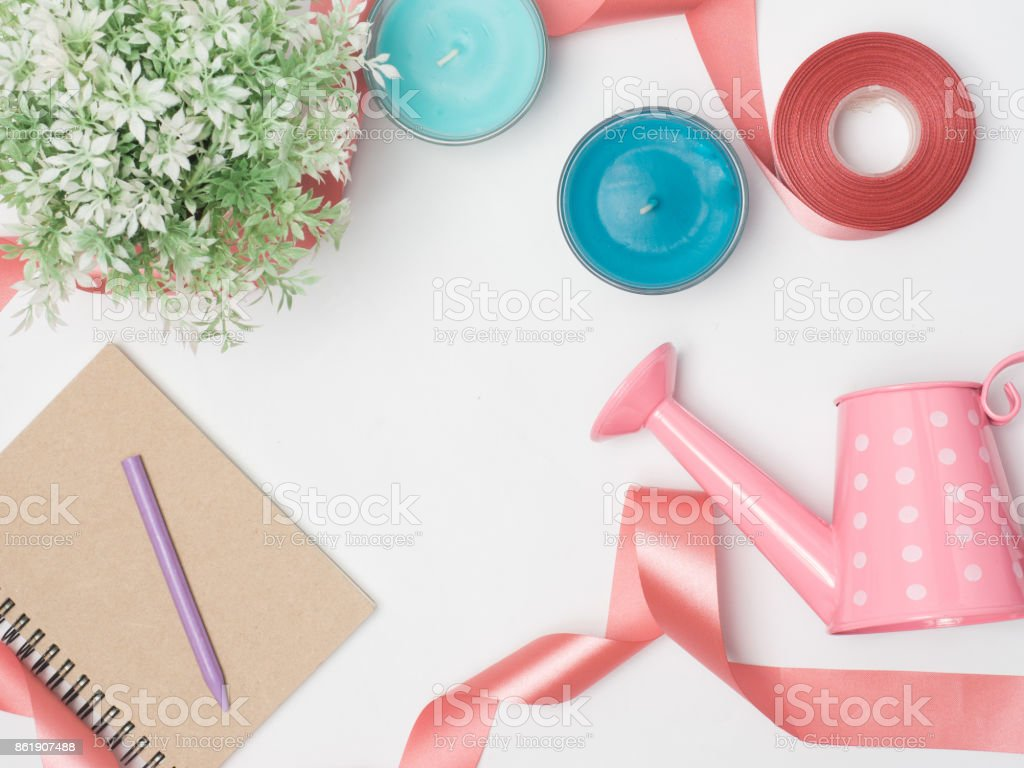 Flat lay, top view office table desk frame. feminine desk workspace with laptop, watch on white background.Love concept top view composition.note for something in love emotin. stock photo