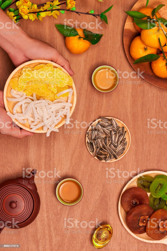 Flat lay Vietnamese new year food and drink on rustic red wooden table top. stock photo