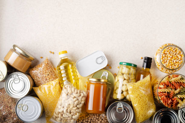 Flat lay view at kitchen table full with non-perishable foods. Spase for text Flat lay view at kitchen table full with non-perishable foods. Spase for text food staple stock pictures, royalty-free photos & images
