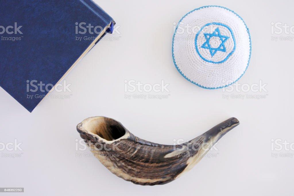 Flat lay view of Shofar, Torah book and Kippa background stock photo