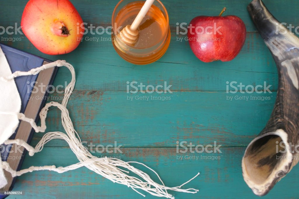 Flat lay view of Torah book tallit pomegranate honey and apple background stock photo
