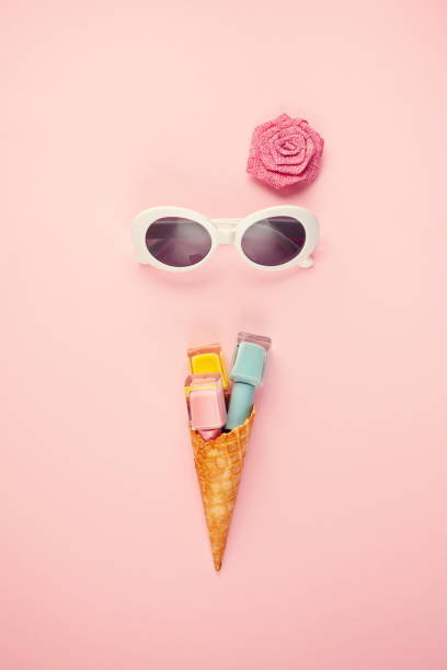 flat lay with bright nail polish in the ice cream cone - nails ice cream imagens e fotografias de stock