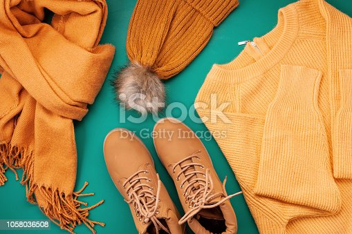 istock Flat lay with comfort warm outfit for cold weather. Comfortable autumn, winter clothes shopping, sale, style in trendy colors idea 1058036508